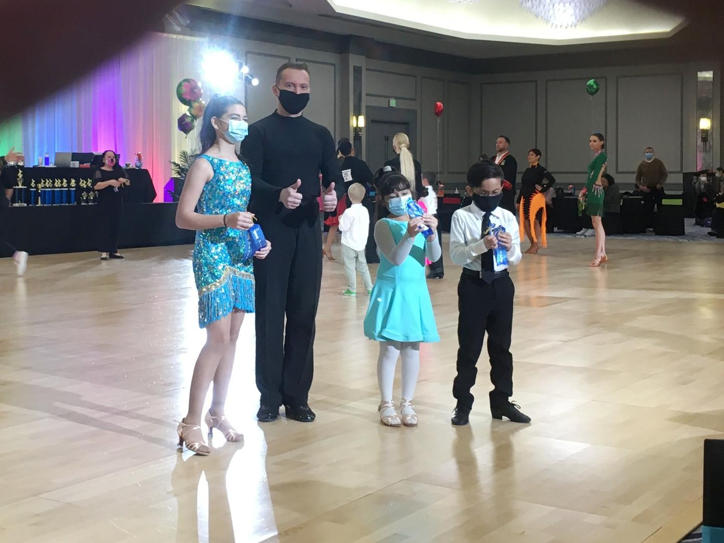 Receiving awards at Texas Challenge DanceSport competition