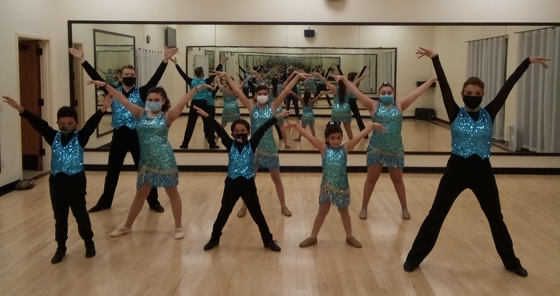 Latin Fusion formation team at Holiday Dance Showcase